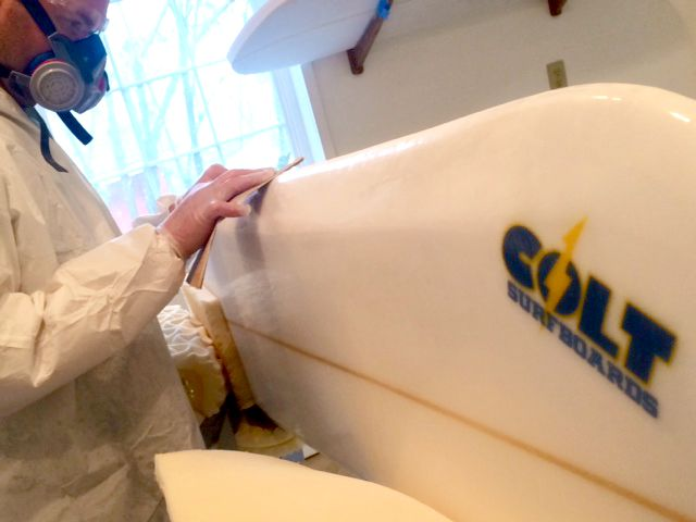 Colter Shaping the Surfboard